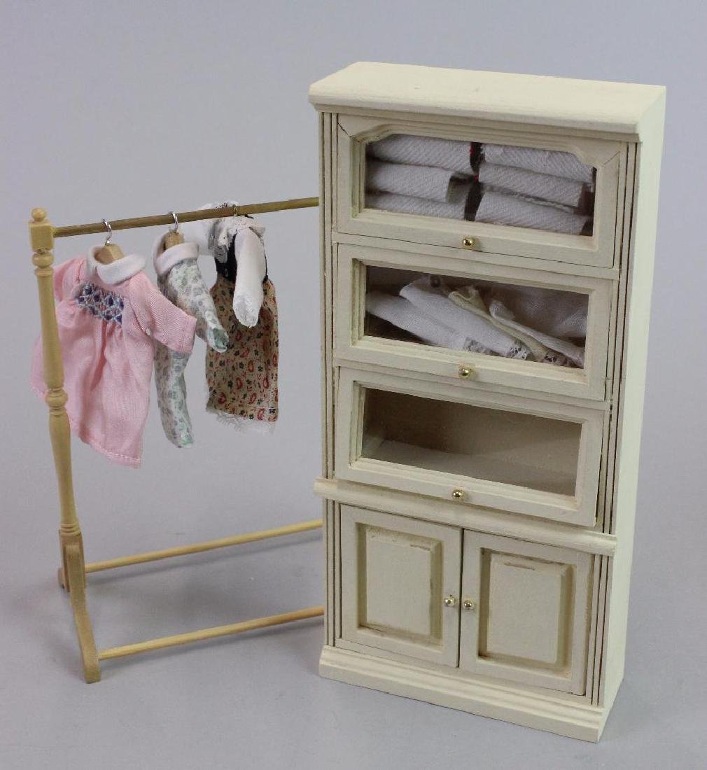 3 little girl dresses, dress rack and tall display case