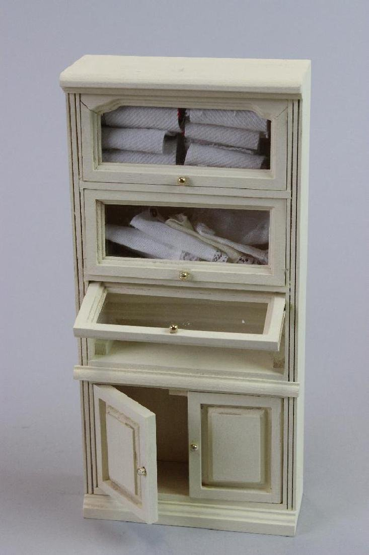3 little girl dresses, dress rack and tall display case - 3