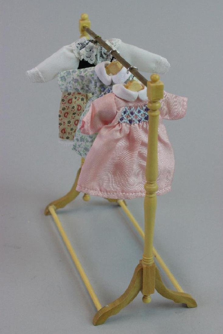 3 little girl dresses, dress rack and tall display case - 4
