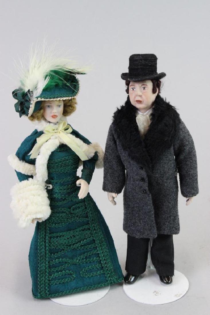 Winter lady green dress; winter dressed man