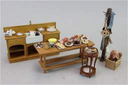 Hotel Kitchen sink and coat rack; Tea prep table; and
