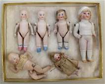 LOT OF (6) SMALL ANTIQUE ALL BISQUE GERMAN DOLLS.
