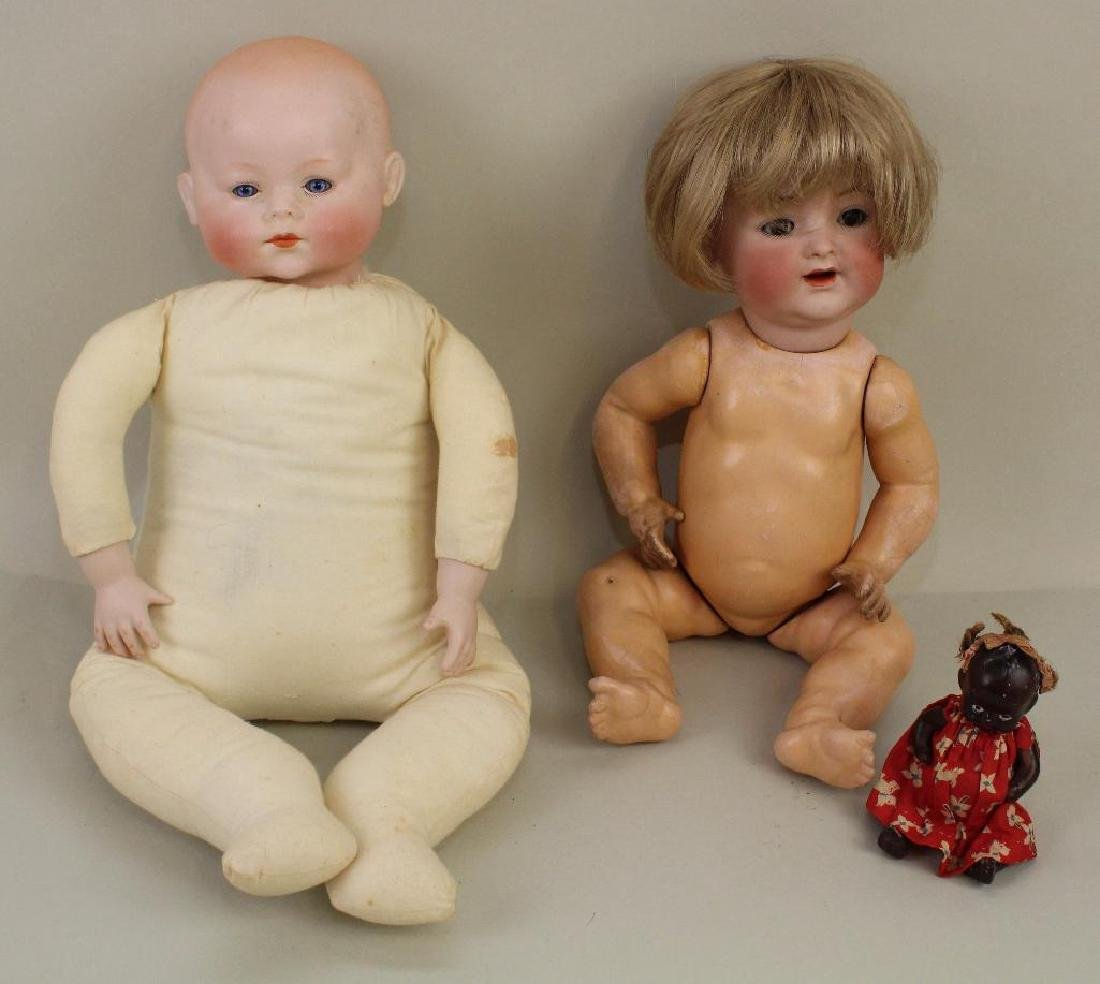 PAIR OF ANTIQUE BISQUE HEAD CHARACTER BABY DOLLS.