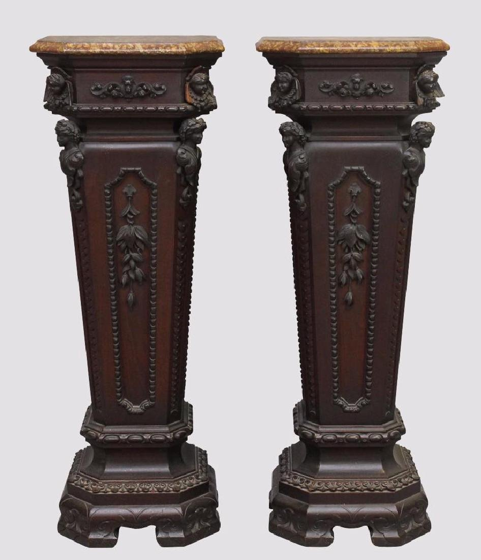Pair of Richly Carved Mahogany Marble Pedestals