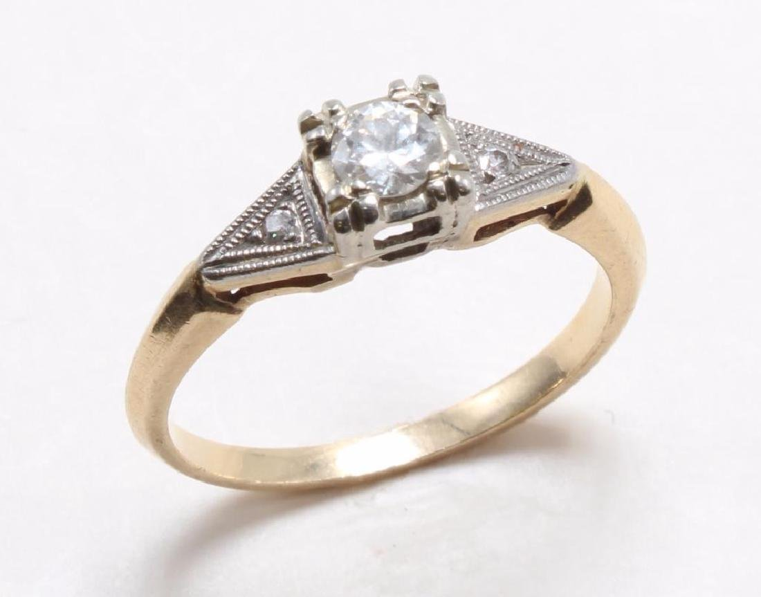 RING. DIAMOND. 14K YELLOW GOLD