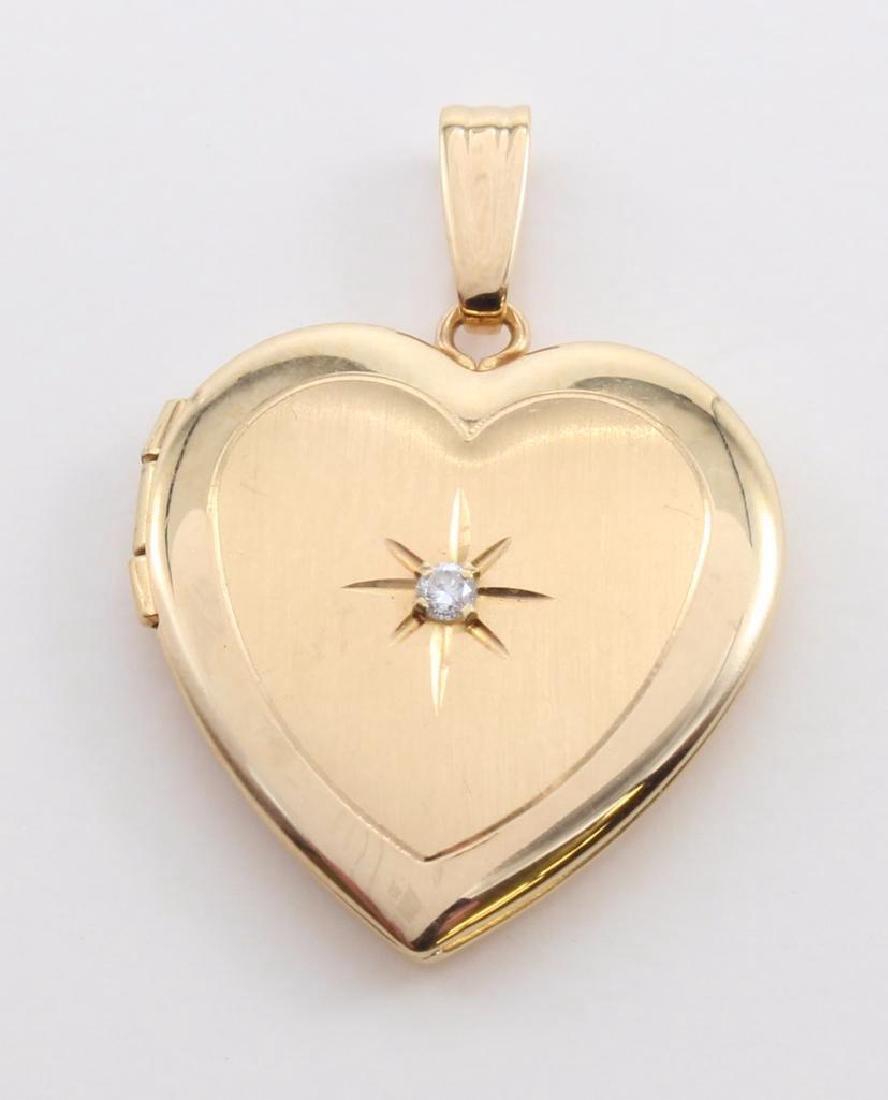 PENDANT. 14K YELLOW GOLD HEART LOCKET WITH DIAMOND