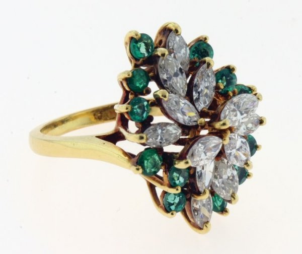 2001: Emerald and diamond ring.