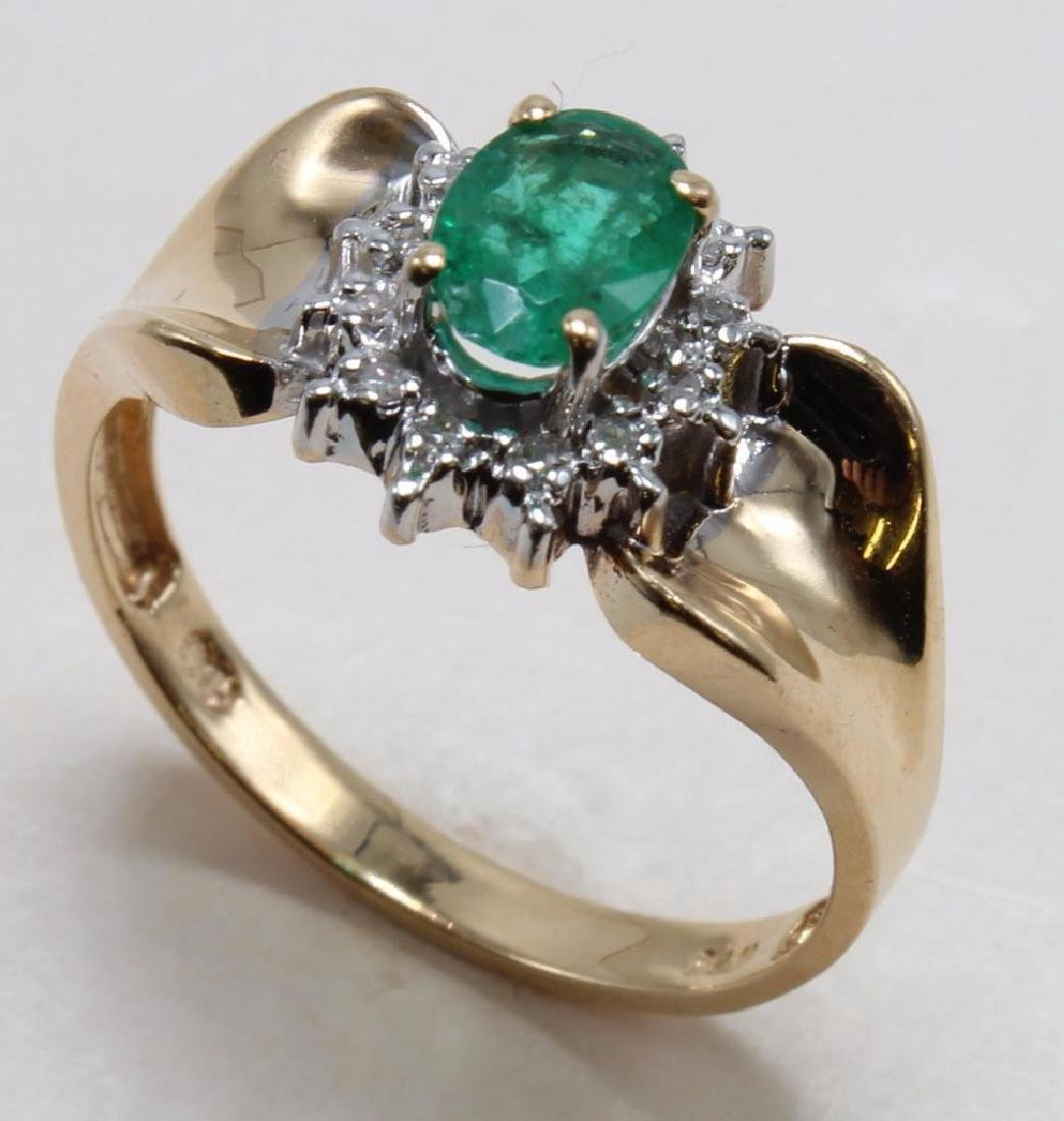 RING. EMERALD OVAL WITH DIAMONDS. 14K YELLOW GOLD