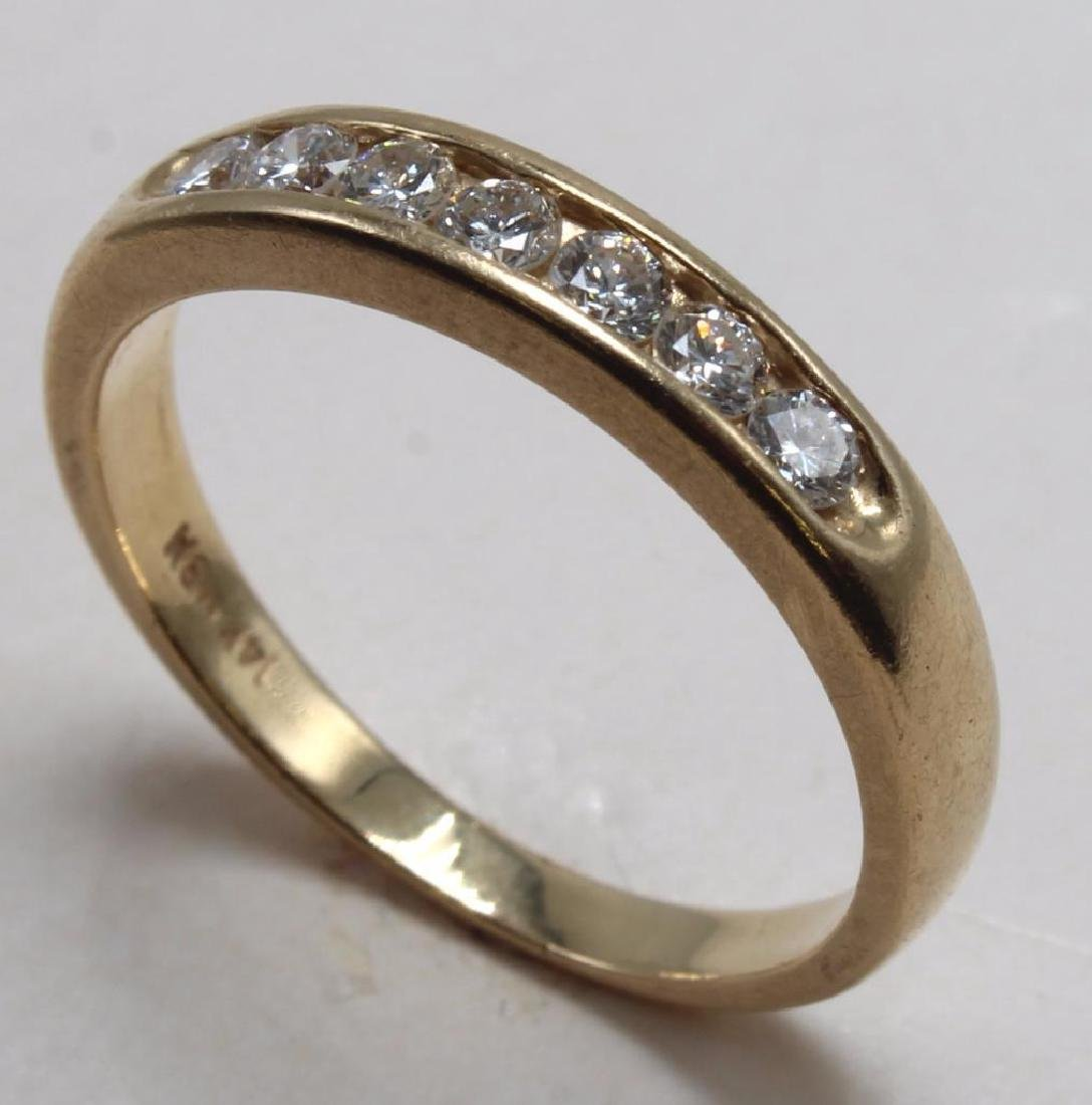 RING. DIAMOND. 14K YELLOW GOLD WEDDING BAND