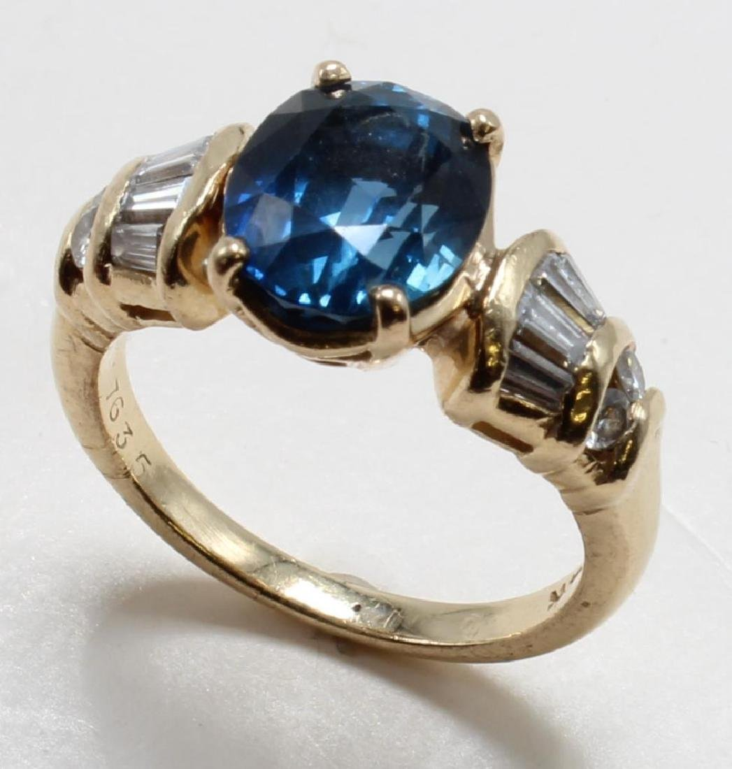 RING. SAPPHIRE AND DIAMOND. 14K YELLOW GOLD