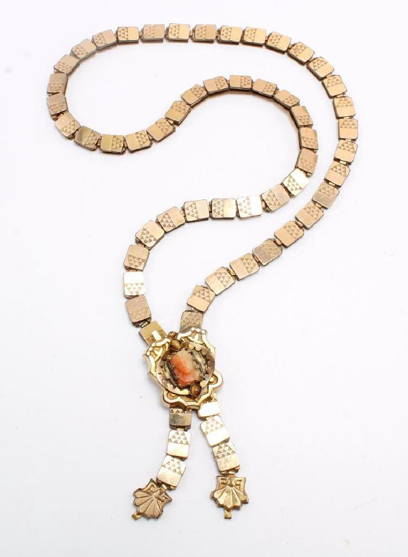NECKLACE. VICTORIAN. CARVED CORAL CAMEO WITH TIGER EYE.