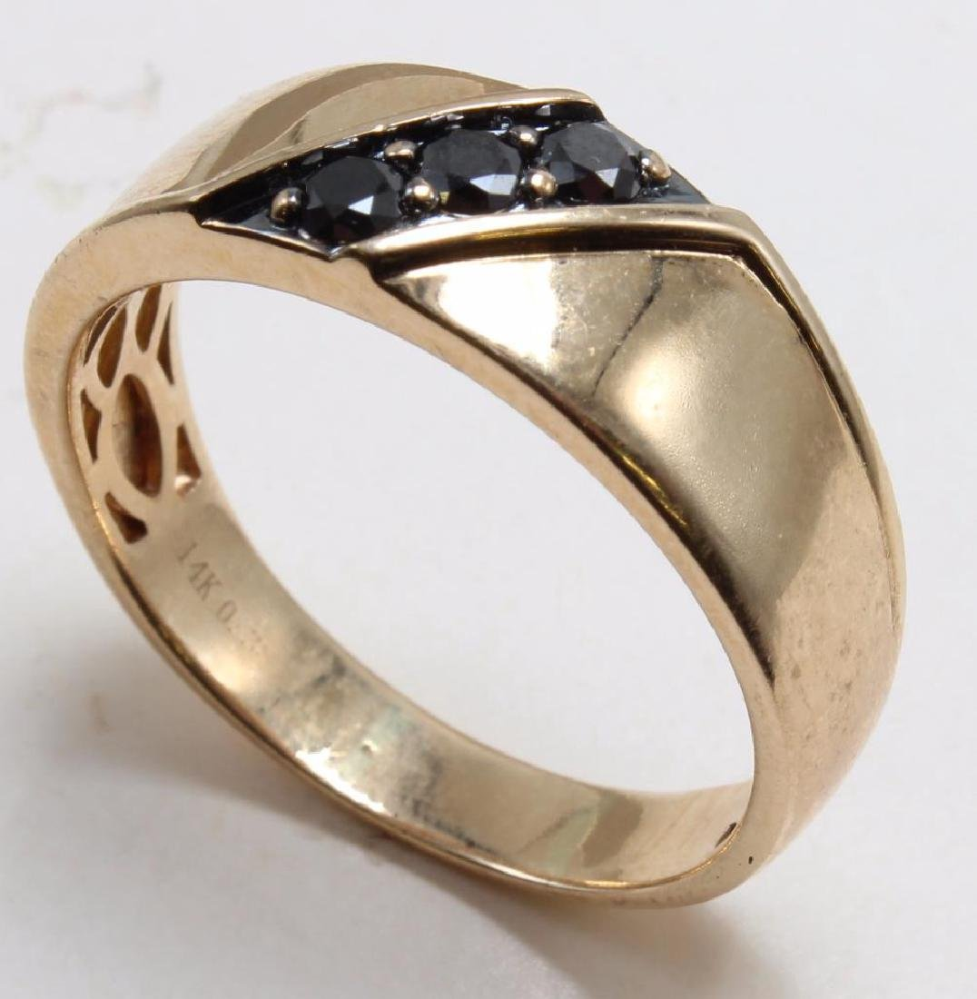 RING. BLACK DIAMOND. 14K YELLOW GOLD