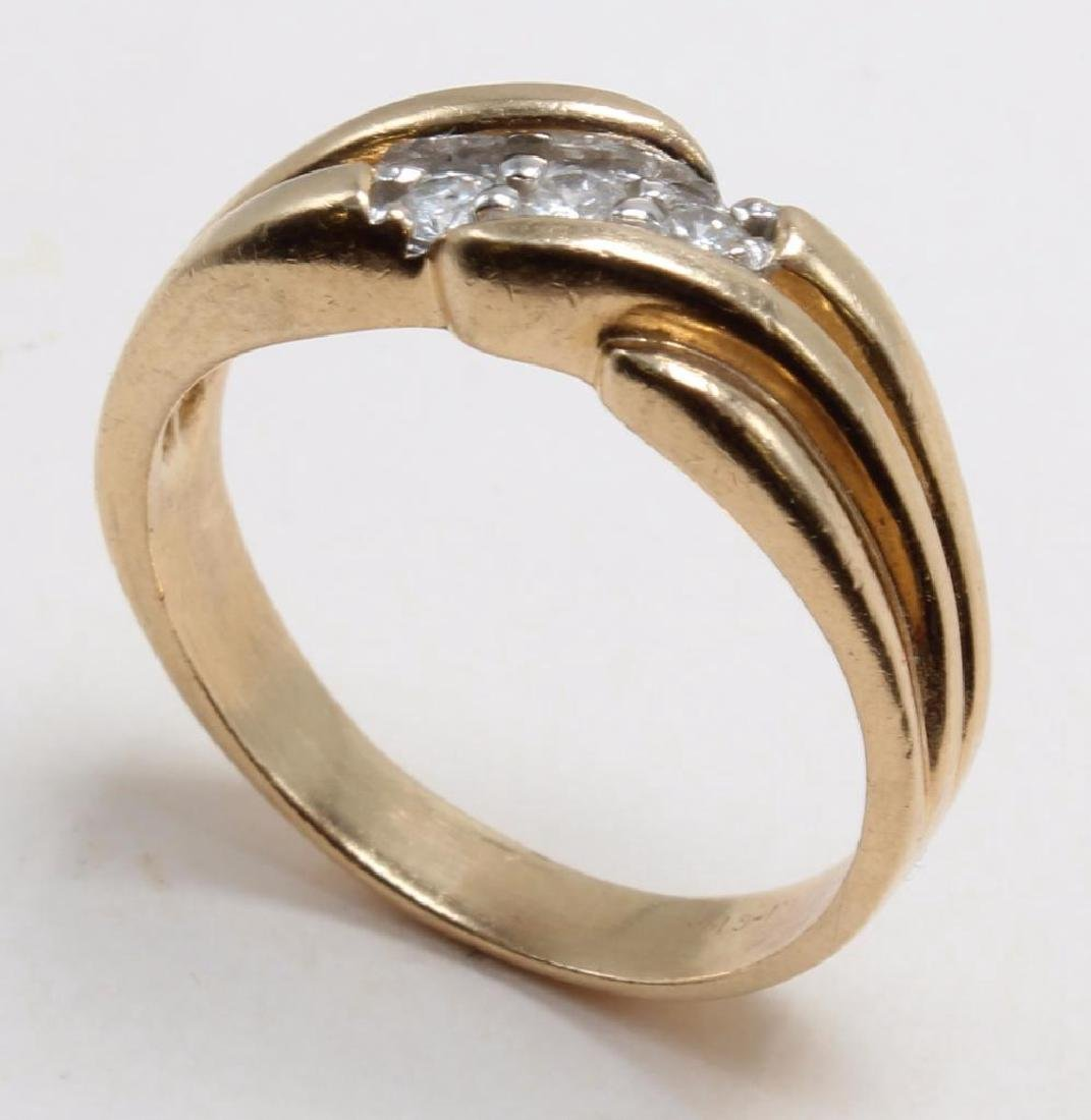 RING. DIAMOND. 14K YELLOW GOLD