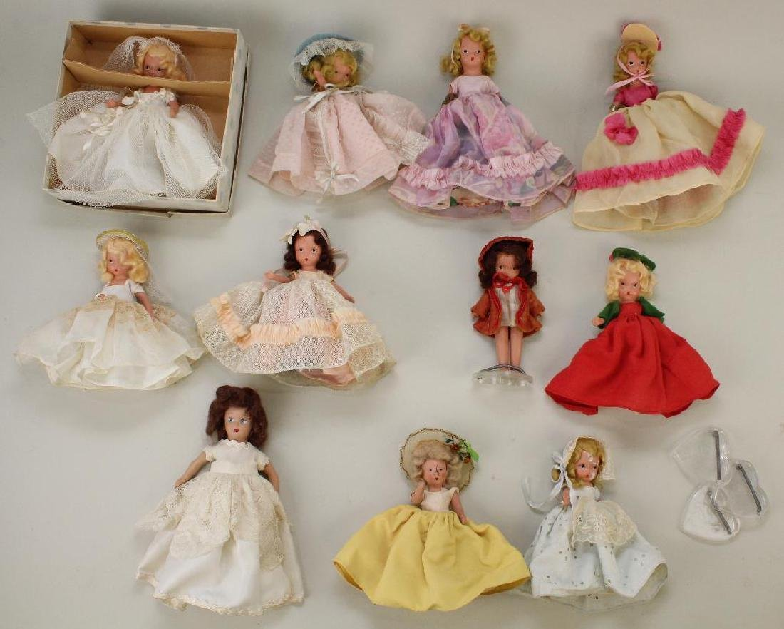 LOT OF (6) TAGGED NASB STONE BISQUE DOLLS.