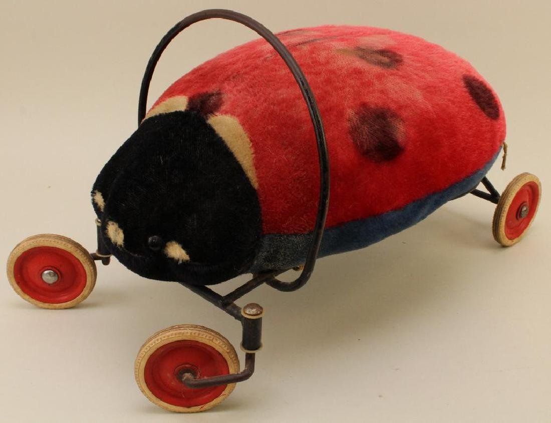 MARKED STEIFF MOHAIR LADYBUG RIDE ON TOY.
