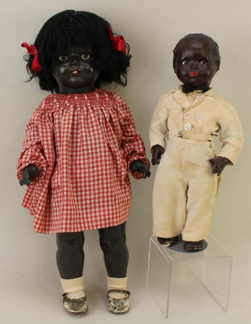 PAIR OF UNMARKED COMPOSITION BLACK DOLLS.