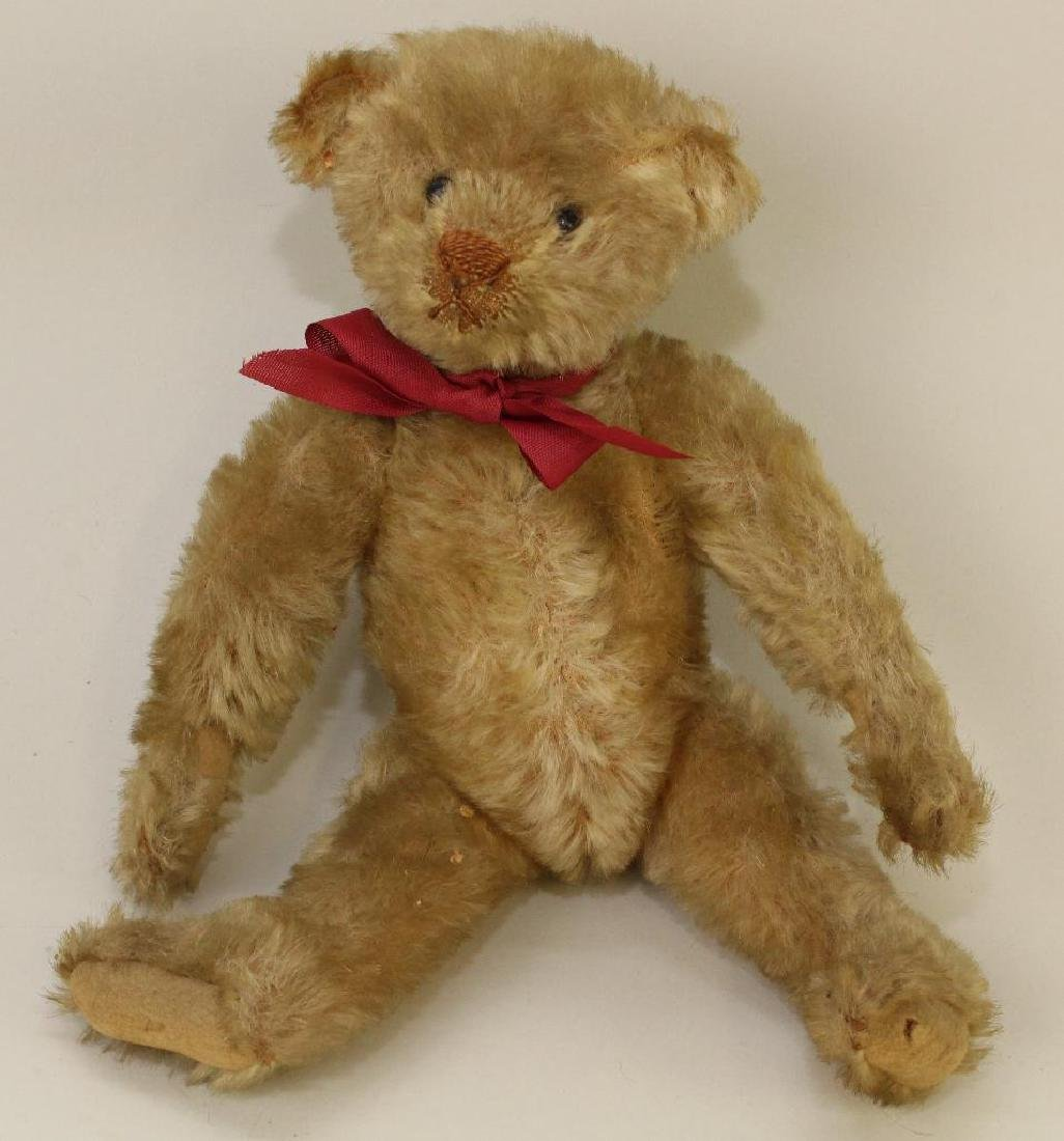"""10 1/2"""" UNMARKED ANTIQUE MOHAIR BEAR."""