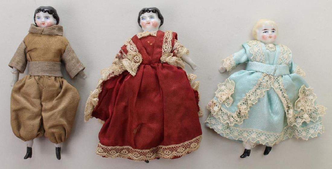 "LOT OF (3) ANTIQUE CHINA HEAD DOLLS: 4"", 41/4"", 4 1/4""."