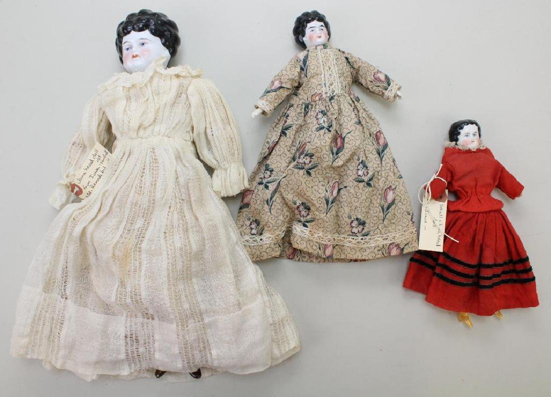 "LOT OF (3) ANTIQUE CHINA HEAD DOLLS: 8 1/2"", 10 1/2"","