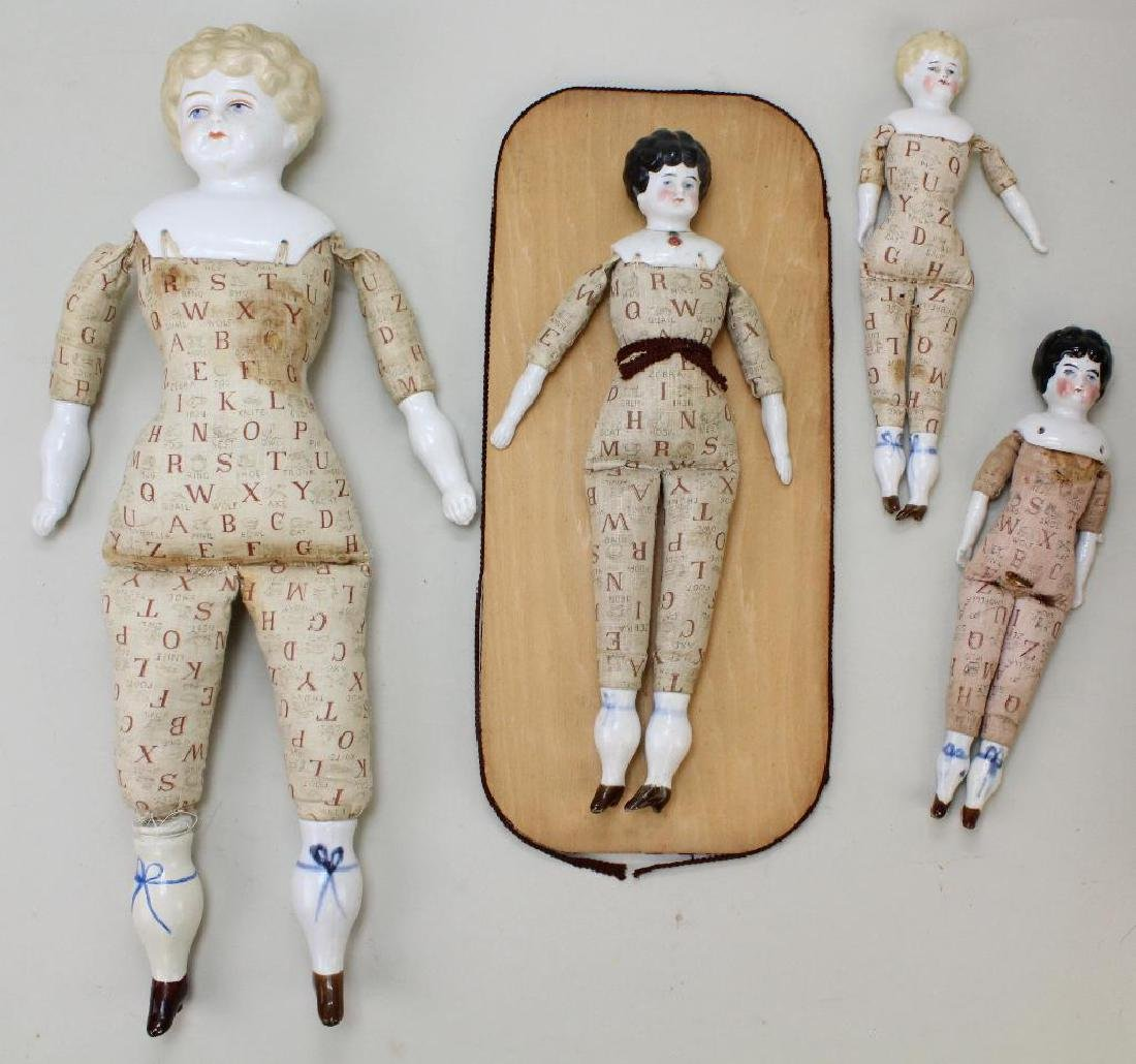 LOT OF (4) ANTIQUE CHINA LOW BROW DOLLS.