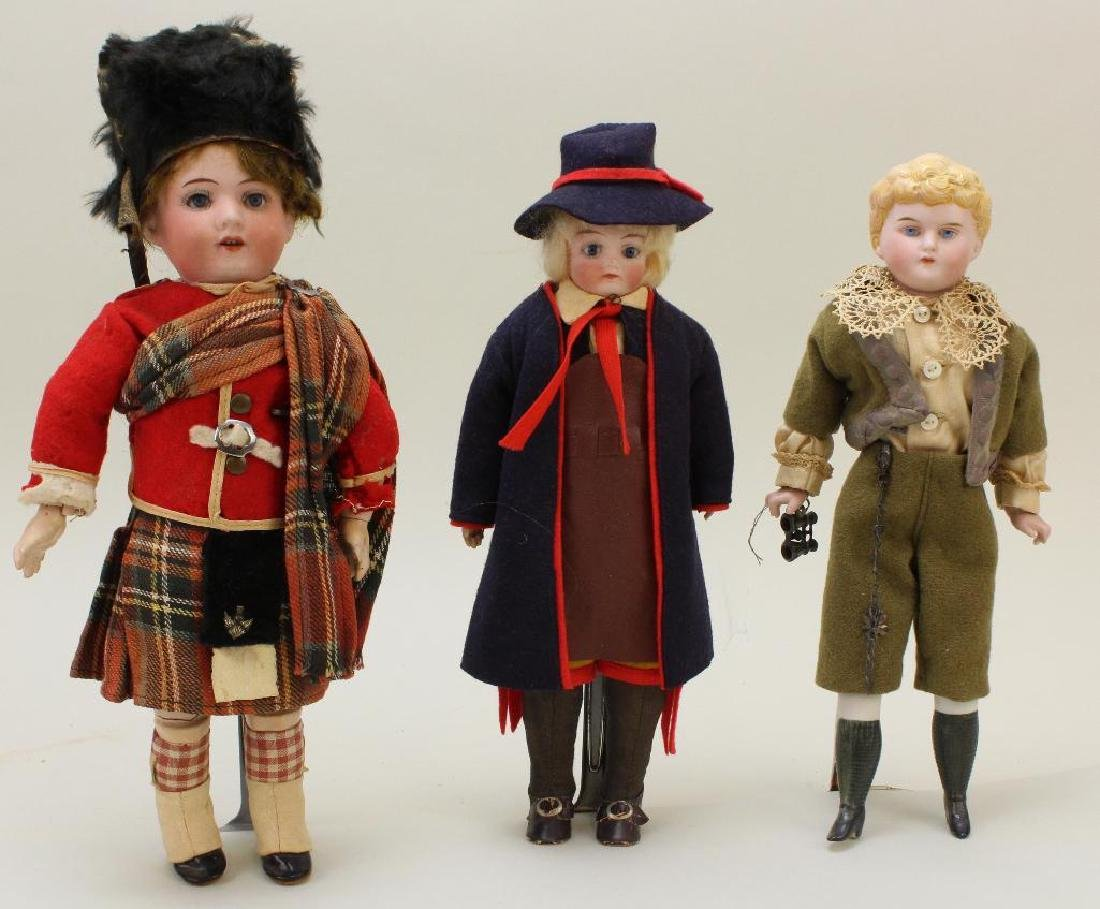 LOT OF (3) ANTIQUE BISQUE HEAD MALE DOLLS.