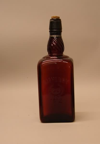 3364: Amber Glass McHenry 1812 Whiskey Bottle