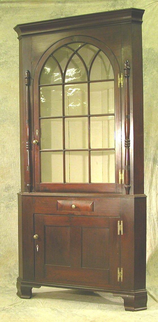 717: Mahogany Two Part Glass Top Corner Cupbo