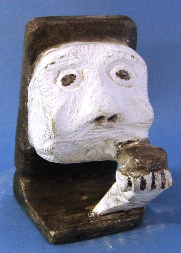 7012: Hand Carved Inuit Face with Hand