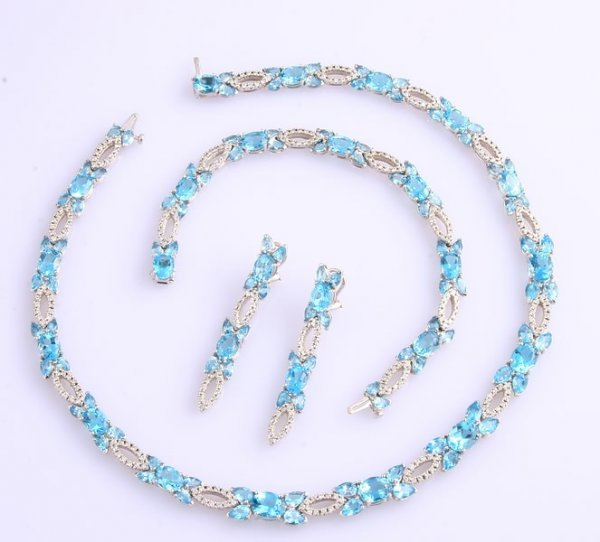 3245: Blue Topaz and Diamond Necklace, Earrings and Bra