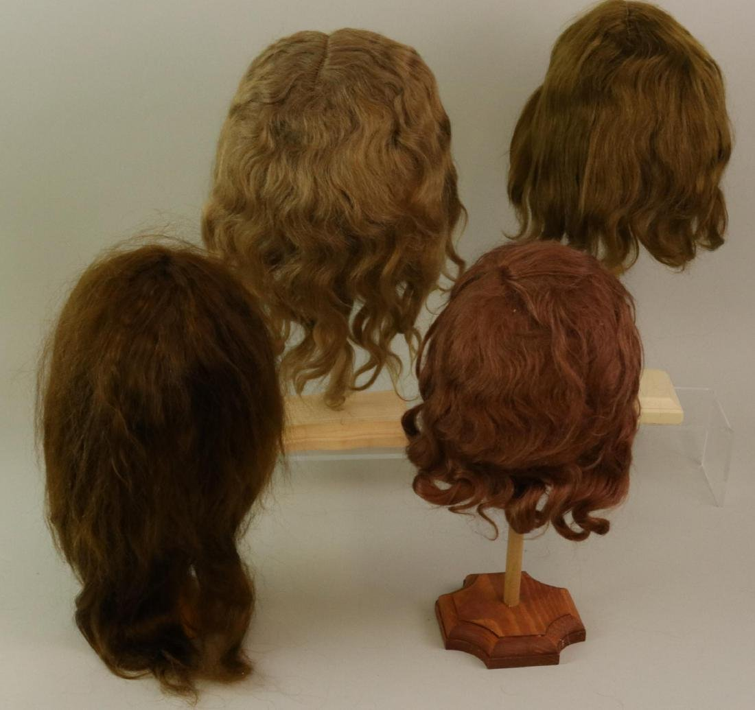 LOT OF DOLL WIGS.