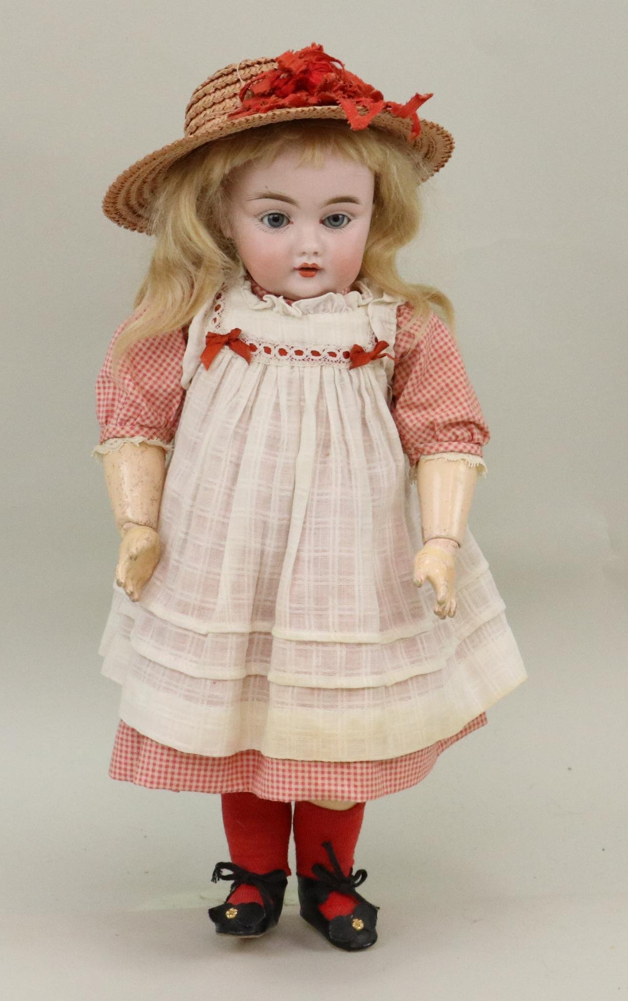 ANTIQUE BISQUE HEAD GERMAN DOLL.