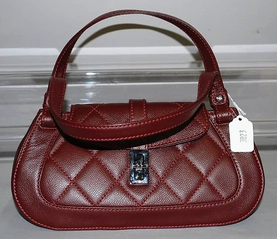 3023: Chanel Burgandy Leather Quilted Handbag