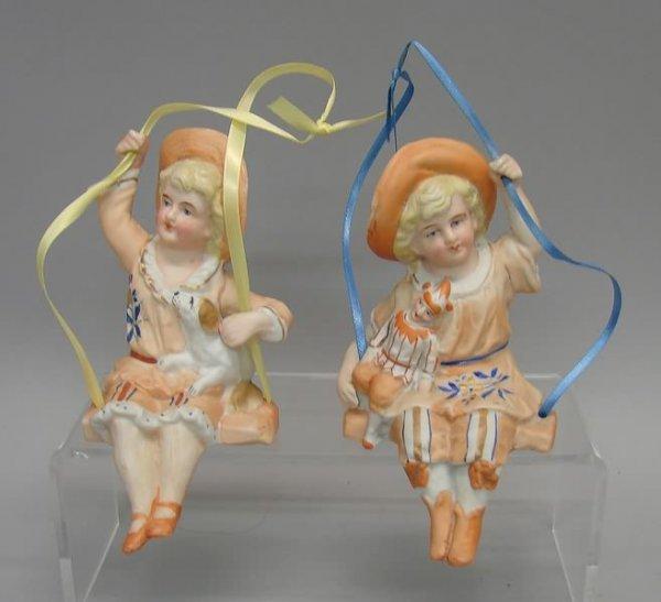 "7019: 2-Bisque ""Swing"" Figurines"