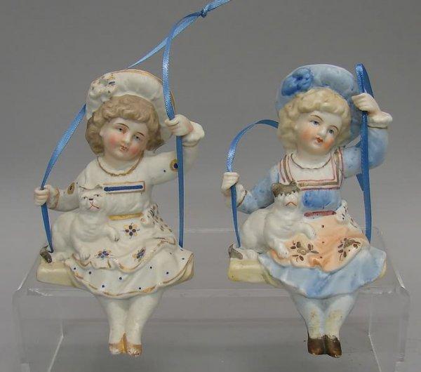 "7021: 2 Bisque ""Swing"" Figurines"