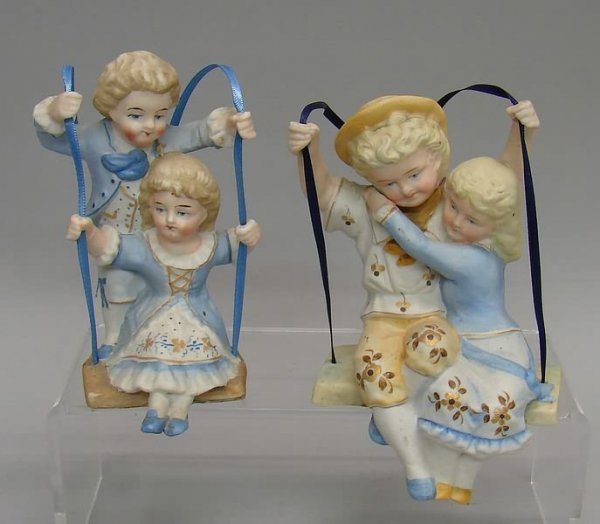 "7022: 2 Bisque""Swing"" Figurines"