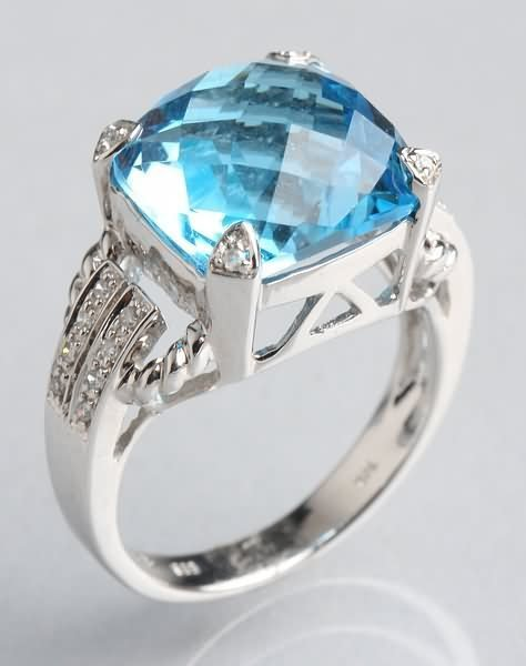 1017: Blue Topaz and Diamond Ring