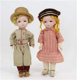 PAIR OF FRENCH BISQUE HEAD DOLLS.