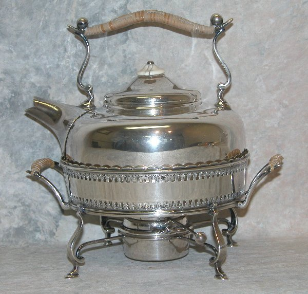 486: Sterling Silver Tea Kettle and Warmer.