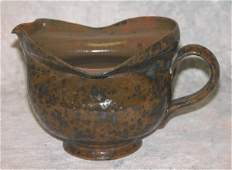 708: George Ohr Pottery Creamer.