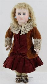 ANTIQUE FRENCH BISQUE HEAD DOLL.