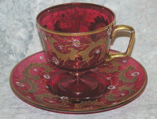 529: Cranberry Glass Cup and Saucer.