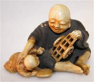 Ivory and Wood Netsuke.