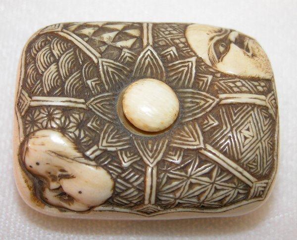 8: Carved Ivory Manju Netsuke.