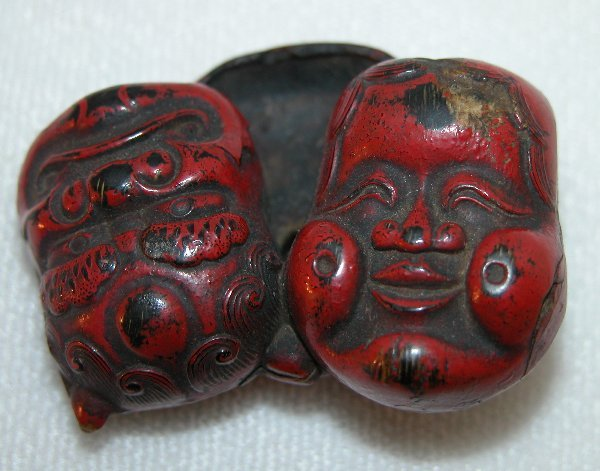 9: Carved Wood Negoro Lacquer Netsuke.