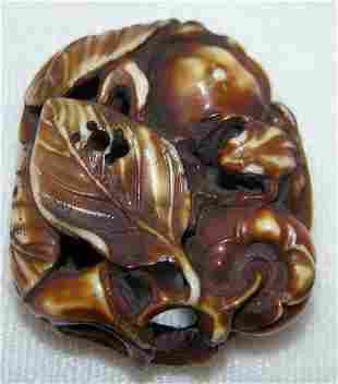 Carved and Stained Ivory Manju Netsuke.