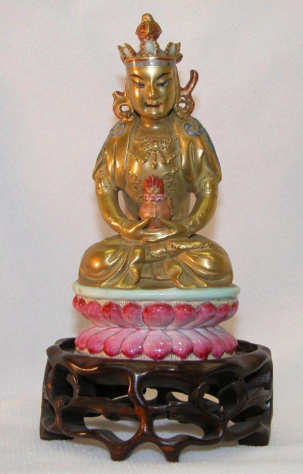 13: Porcelain Figure of Deity.