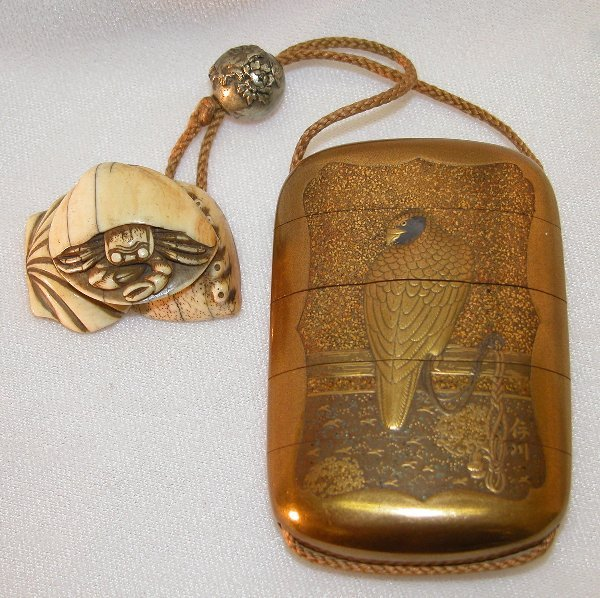 21: Lacquer Inro With Ivory Netsuke and Metal Ojime.