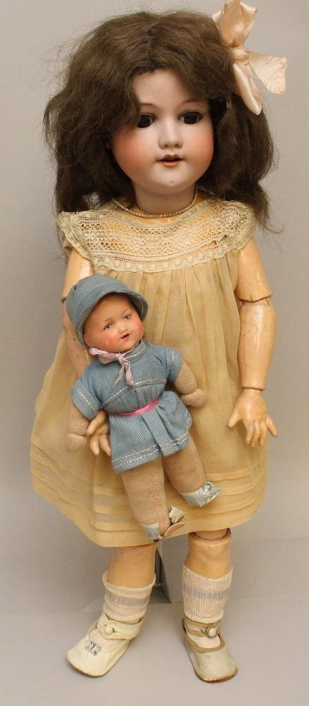 PAIR OF ARMAND MARSEILLE ANTIQUE DOLLS.
