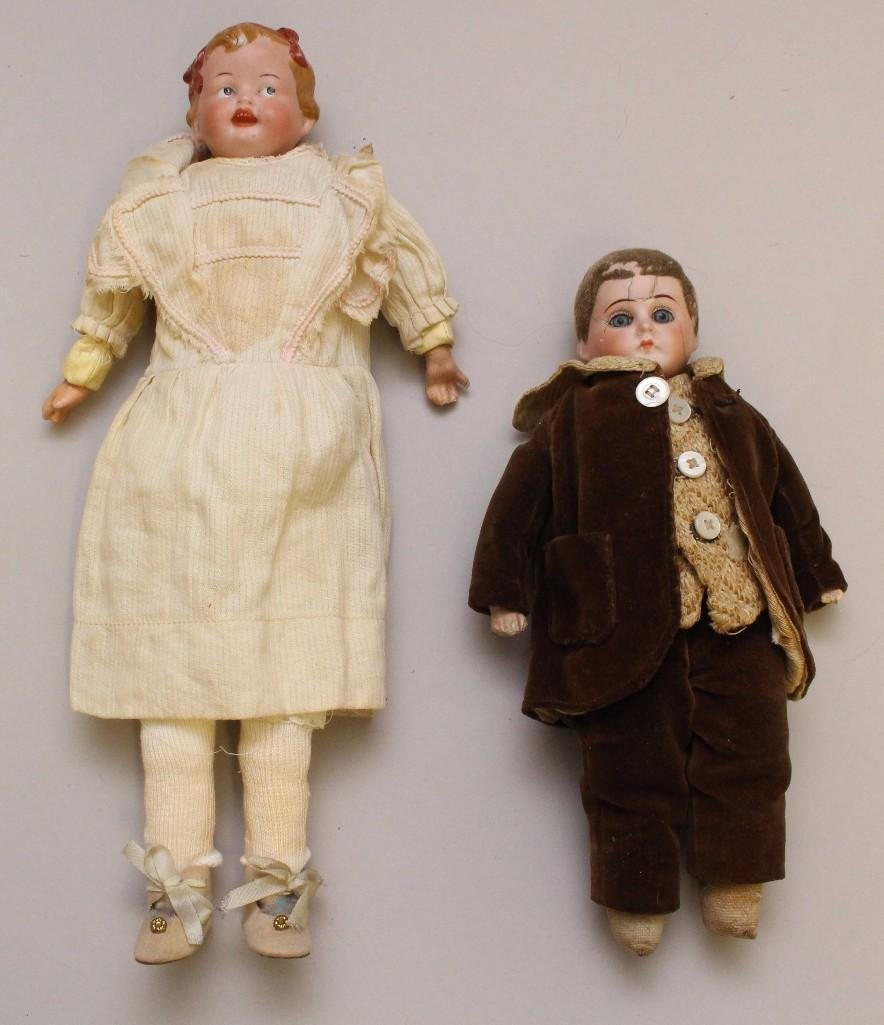 PAIR OF ANTIQUE BISQUE SHOULDER HEAD DOLLS.