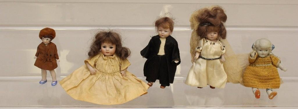 LOT OF (5) ANTIQUE ALL BISQUE DOLLS.